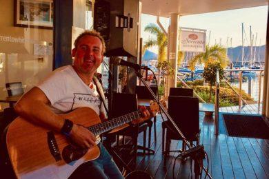 Artist playing music on a guitar in Sorrento Restaurant & Bar, Whitsundays