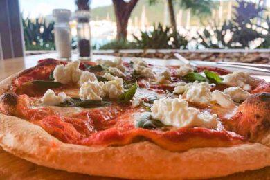 margherita pizza made by la marina restaurant, airlie beach, whitsundays