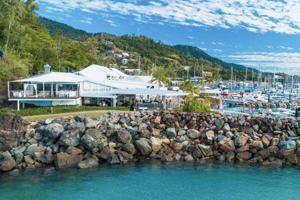 dron eshot of sorrento's restaurant at coral sea marina looking over the boats in Airlie Beach