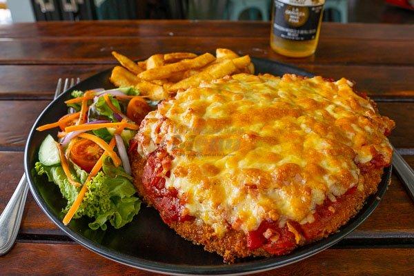 Nancy Bird Parmi served at The Hangar Cafe & Bar, Flametree, Whitsundays, Australia